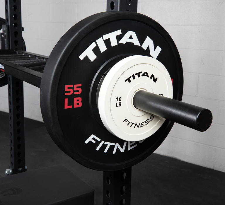 Advertisement - Titan Bumper Plates on a barbell